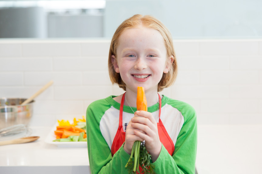 child eating a carrot for lunch